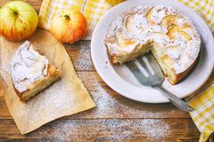 homemade apple pie on plate sprinkled with powdered sugar, piece Royalty Free Stock Image