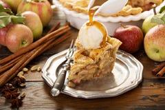 Homemade apple pie slice with vanilla ice cream. And caramel sauce stock image