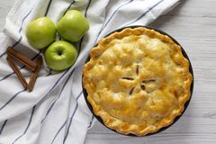 Homemade apple pie on a white wooden surface, top view. Flat lay, overhead, from above.  stock images