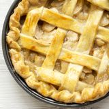 Homemade apple pie on white wooden table, view from above. Flat lay, overhead, top view.  stock images