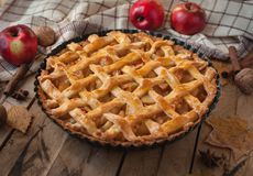 Homemade apple pie on wooden background royalty free stock photo