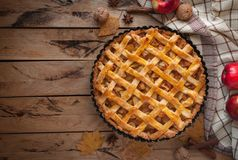 Homemade apple pie on wooden background, top view, copy space royalty free stock photography