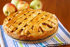 Homemade apple pie on wooden table Stock Photos