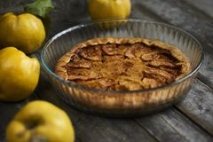 Homemade apple quince pie with fresh fruits on rustic wooden bac Stock Image