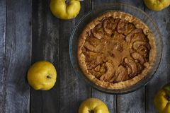 Homemade apple quince pie with fresh fruits on rustic wooden bac Stock Photos