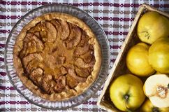 Homemade apple quince pie with fresh fruits on rustic wooden background. Top view royalty free stock photography