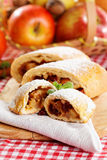 Homemade apple strudel. Slice of an apple strudel with fresh ingredients Royalty Free Stock Photos