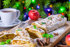Homemade apple strudel with powdered sugar and mint leaves stock photos
