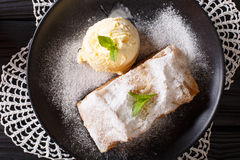 Homemade apple strudel with vanilla ice cream and mint closeup o. N the table. horizontal view from above Royalty Free Stock Images