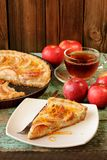 Homemade apple tart with sour cream with black tea and whole fre Stock Photos