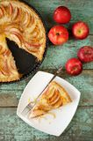 Homemade apple tart with sour cream and five red fresh apples to Stock Photo