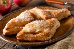 Homemade Apple Turnovers. Delicious freshly baked homemade apple turnovers with coarse sugar topping royalty free stock images