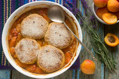 Homemade apricot cobbler with lavender. Selective focus. Royalty Free Stock Images