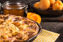 Homemade apricot tart with almonds and fresh fruits Royalty Free Stock Image