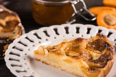 Homemade apricot tart with almonds and fresh fruits Royalty Free Stock Photography