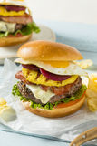 Homemade Aussie Pineapple and Beet Cheeseburger Stock Images