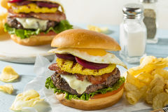 Homemade Aussie Pineapple and Beet Cheeseburger Royalty Free Stock Photos