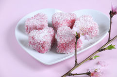 Homemade Australian style pink heart shape small lamington cakes - closeup. Royalty Free Stock Photos