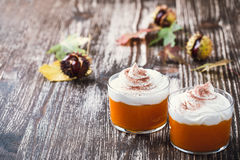 Homemade autumn dessert of pumpkin mousse with whipped cream Royalty Free Stock Image
