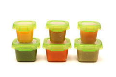 Homemade Baby Food. Six containers of homemade baby food on a white background Royalty Free Stock Photos