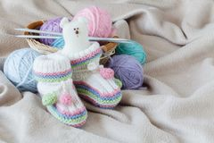 Homemade baby shoes, leisure time on pregnancy Stock Photo
