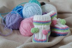 Homemade baby shoes, leisure time on pregnancy Royalty Free Stock Image