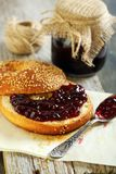 Homemade bagel with jam for breakfast. Stock Photo