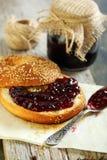 Homemade bagel with jam for breakfast. Stock Photo