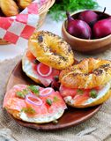 Homemade bagel with smoked salmon, cream cheese, capers and onions Stock Photography
