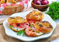Homemade bagel with smoked salmon, cream cheese, capers and onions Royalty Free Stock Images