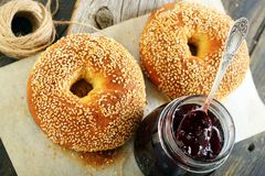Homemade bagels and lingonberry jam closeup. Royalty Free Stock Photo