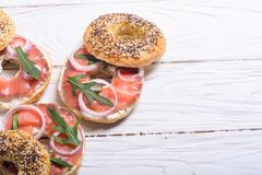 Homemade bagels with salmon. Cream cheese and onion Royalty Free Stock Photo