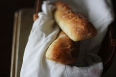 2 Homemade Baguette In A Bread Basket. Who doesn`t love some fresh bread? These were just made 10 minutes or so before I photographed them. Captured on top of a stock photography