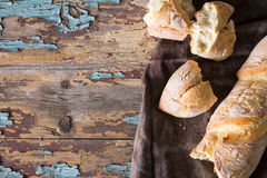 Homemade baguettes on wooden table Royalty Free Stock Photos