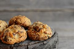 Homemade baked biscuits on a wooden background. Sweet biscuits with walnuts. Closeup Stock Photography
