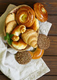 Homemade baked buns brioche, crescent rolls, croissants Stock Photos