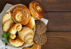 Homemade baked buns brioche, crescent rolls, croissants Stock Photo