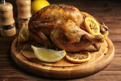Homemade baked chicken with lemon royalty free stock image