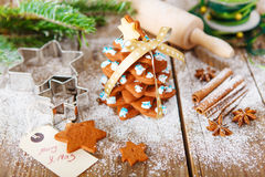 Homemade baked Christmas gingerbread tree on vintage wooden back Stock Image