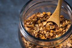Homemade baked granola in a glass jar, closeup Royalty Free Stock Photos