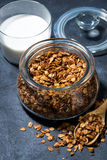 Homemade baked granola in a glass jar, top view Royalty Free Stock Image