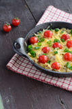 Homemade baked minced meat with cheese and cherry tomatoes Royalty Free Stock Photo