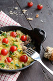 Homemade baked minced meat with cheese and cherry tomatoes Stock Photo