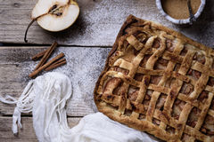 Homemade baked organic pear pie. Gourmet fruit dessert on wooden Royalty Free Stock Photography