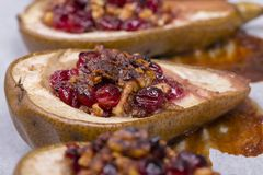Homemade Baked Pears With Cottage Cheese, Honey, Red Cranberries And Walnuts, Close Up Stock Photography