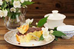 Homemade baked pudding with chololate icing, jasmine flowers and Stock Image