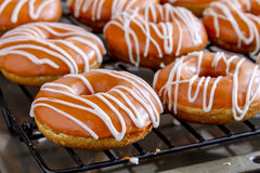 Homemade Baked Pumpkin Donuts with Glaze Stock Photo