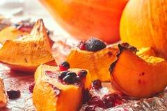 Homemade baked sweet pumpkin with cranberries closeup stock image