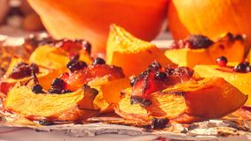 Homemade baked sweet pumpkin with cranberries closeup stock photography
