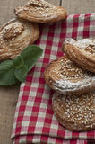 Homemade bakery. Puff cookies with sesame seeds on gingham table cloth Stock Photo